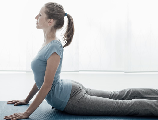 Woman practicing McKenzie Method