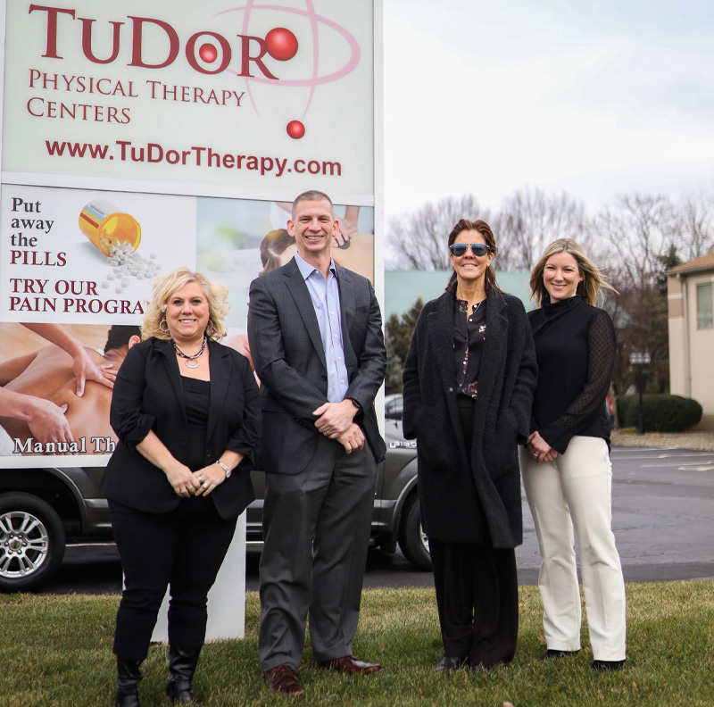 Melissa Sanor-Lucas, Director of Clinic Operations for TuDor, David Angelo, COO of Phoenix, Laura Dye, President and Founder of TuDor, and Jessica Perlozzo, Director of Clinic Operations of Phoenix, gathered at TuDor's Austintown clinic to celebrate the new partnership.